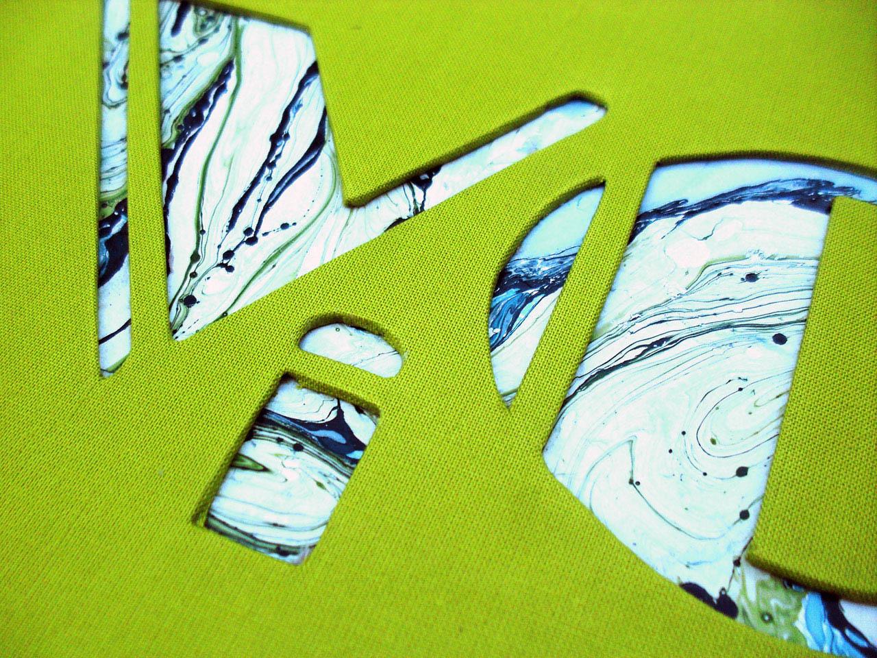 Tapas verde pistacho <br>con letras Art Deco en bajo relieve